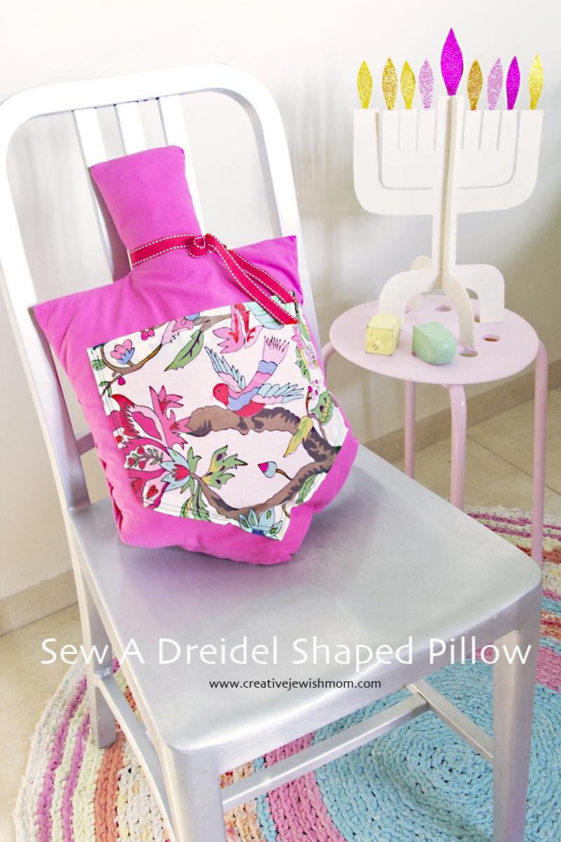 Dreidel Shaped pillow with menorah in back