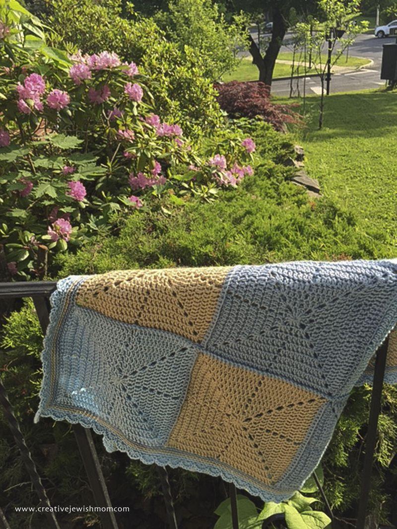 Crochet Starburst baby blanket on railing-2