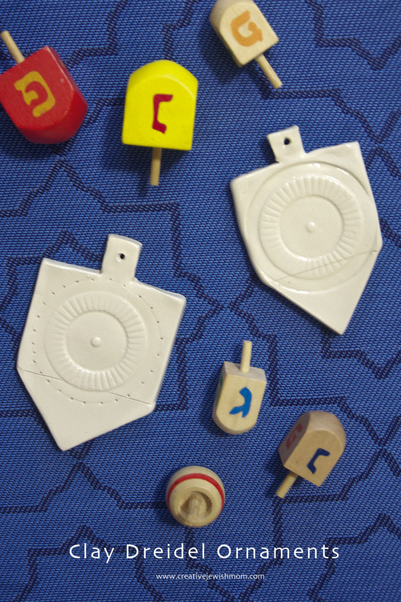 Hanukkah Clay dreidel craft with wooden dreidels