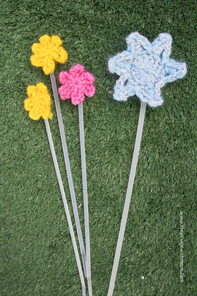 Zip tie bookmarks with crocheted star and flowers