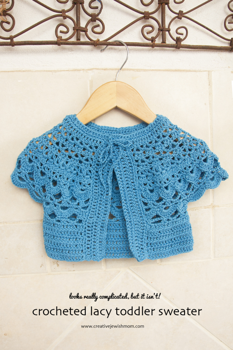 Crocheted lacy toddler sweater