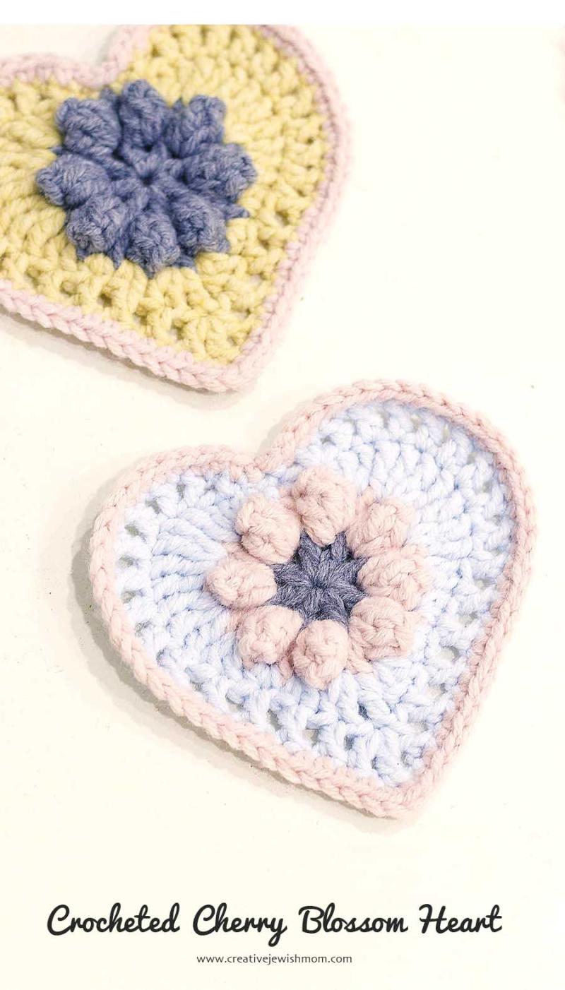 Crocheted cherry blossom center heart with popcorn stitch