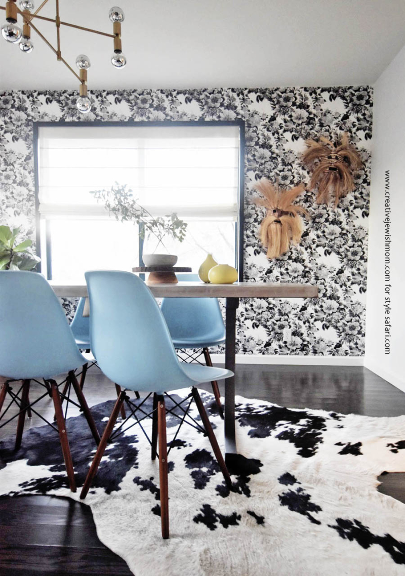 Mid century modern with cowhide and black and floral wallpaper
