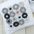 Crocheted flower pillow with applique