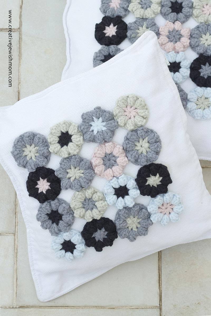 Crocheted cherry blossom pillow