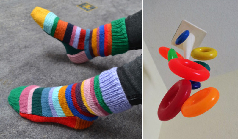 Mobile from baby stacking rings  knit striped socks