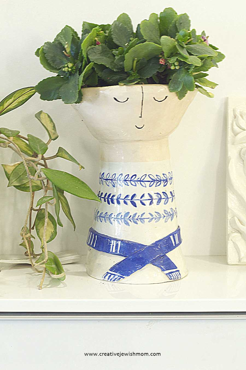 Ceramic Vase With flowers as hair