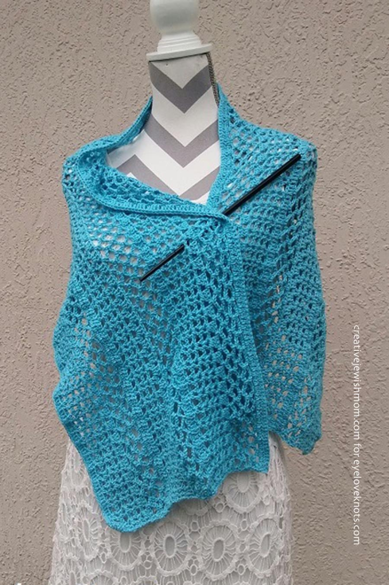 Crocheted lacy shawl