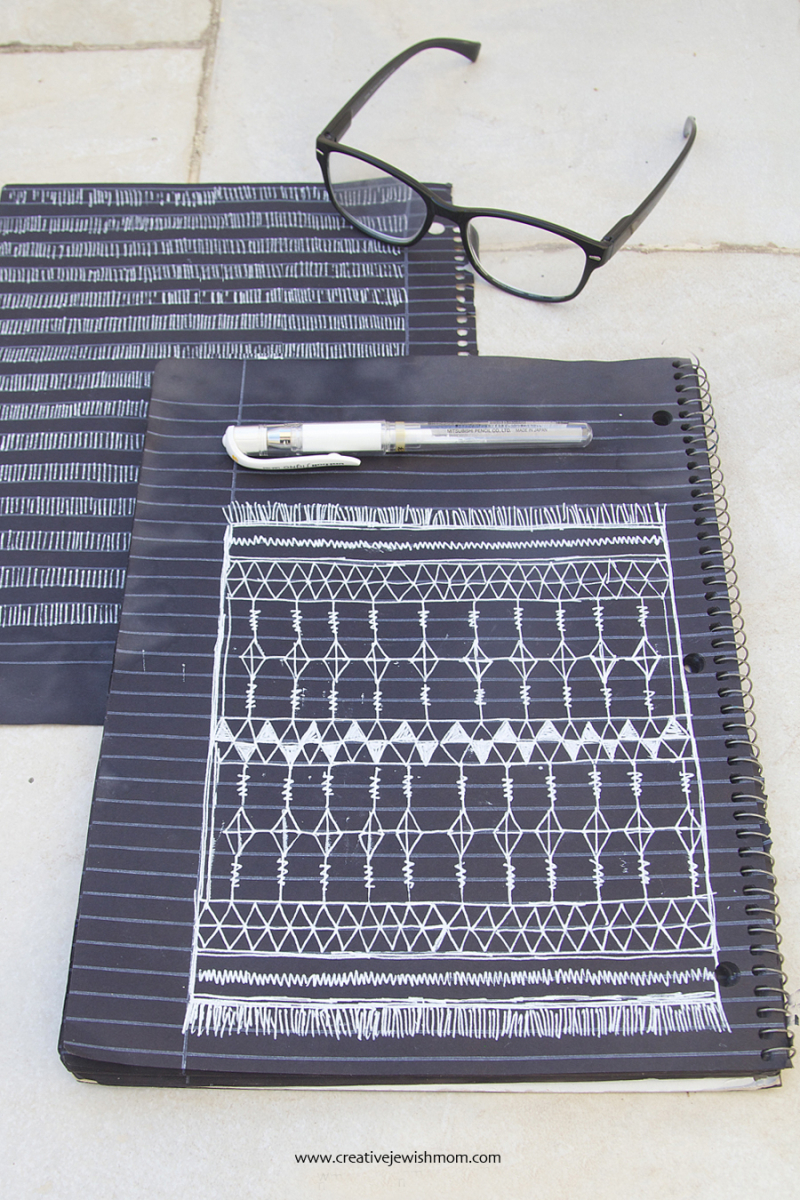 White Gel Pen Doodles On Black Paper