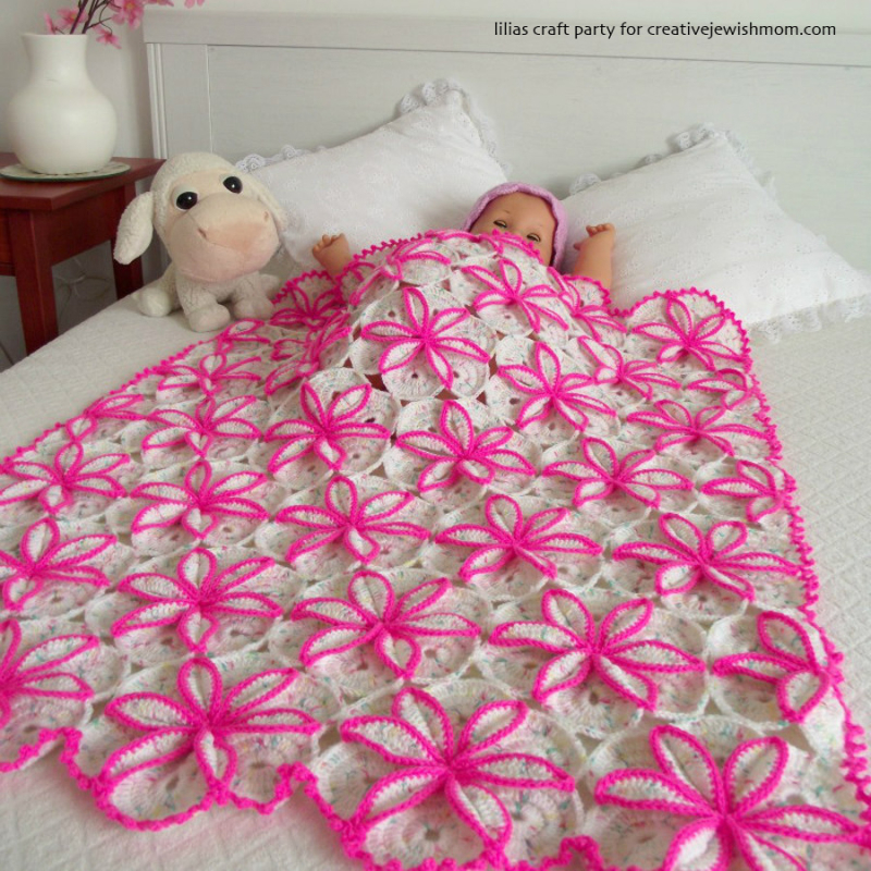 Crocheted flower doll blanket