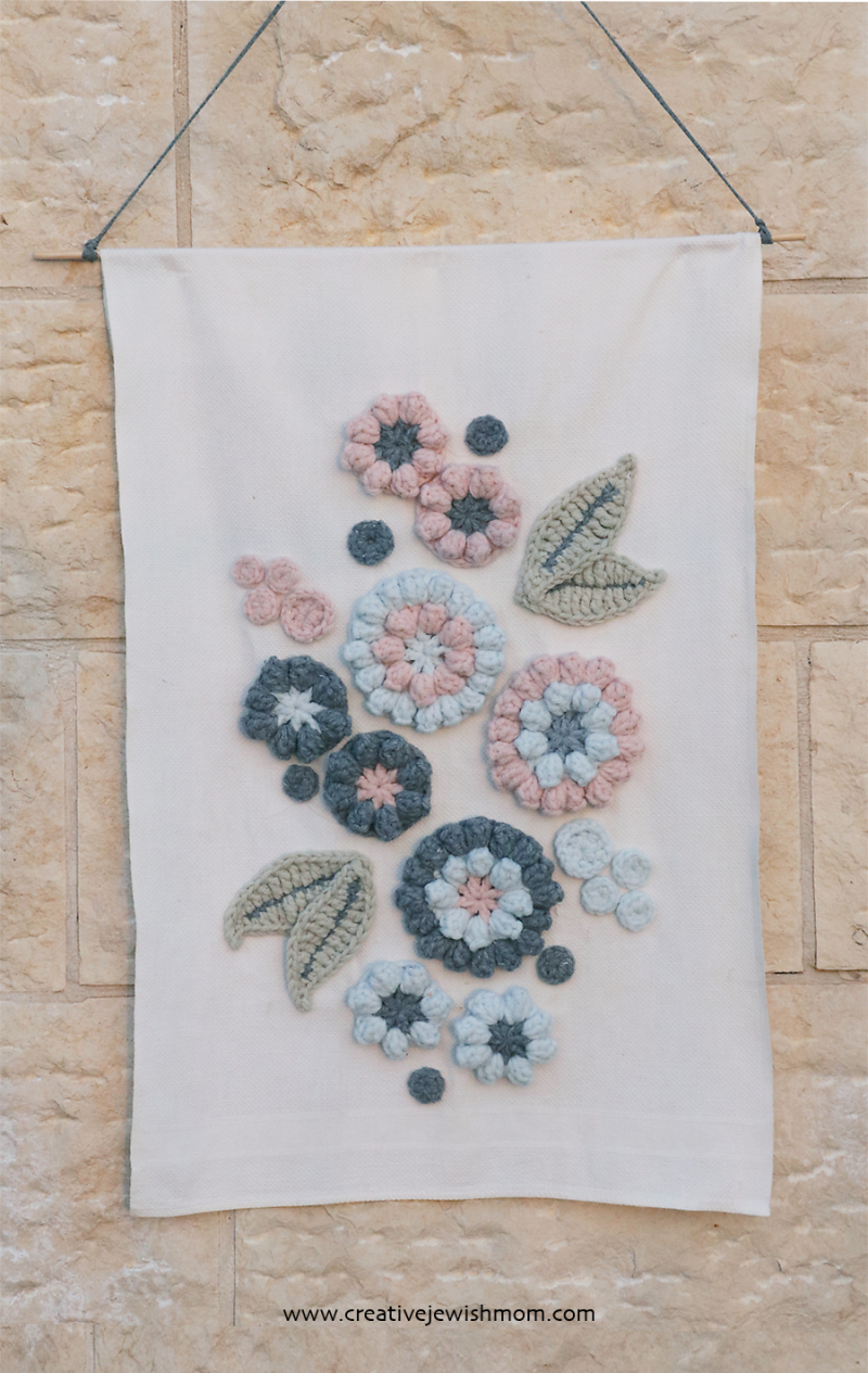 Crocheted-applique-flowers-wall-hanging