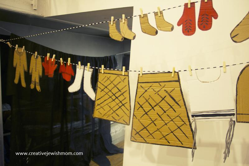 Cardboard baby onesies on a line