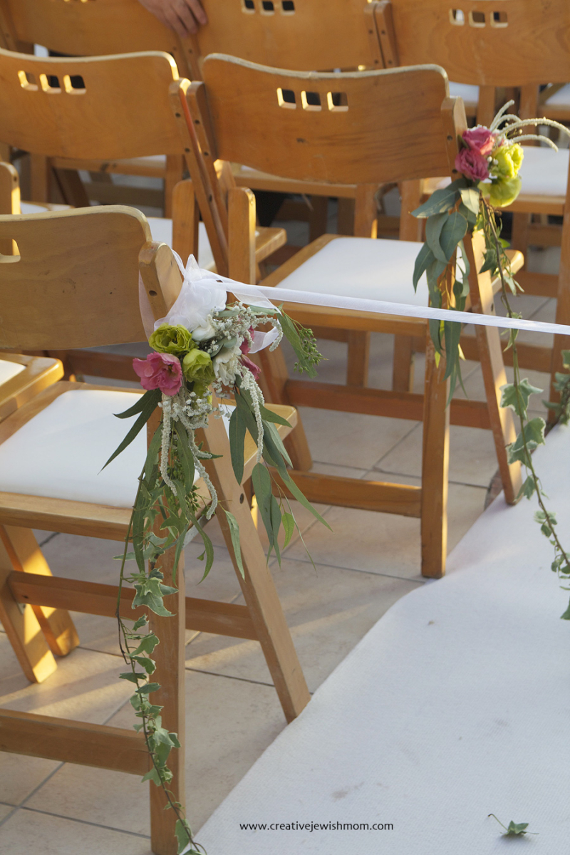Wooden-chairs-with-florals-jewish-wedding