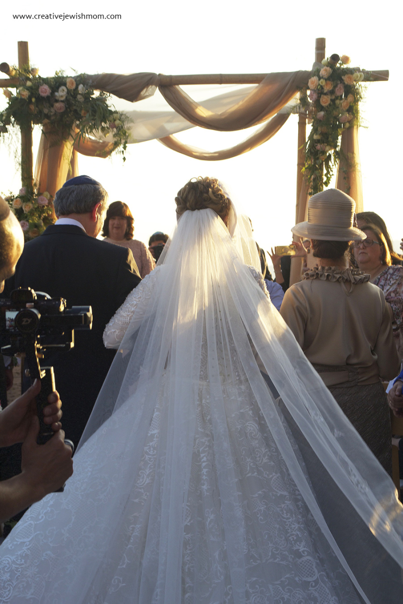 Jewish-wedding-parents-escort-bride-to-chuppah