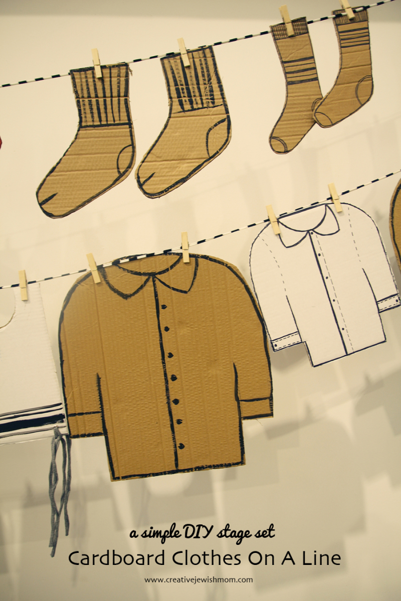 Cardboard clothes on a line party decor