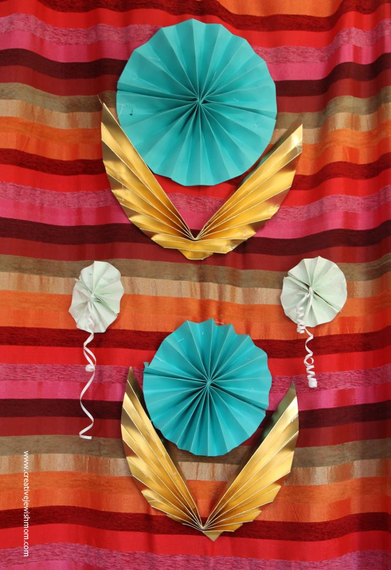 Golden-acccordian-wings-in-succah