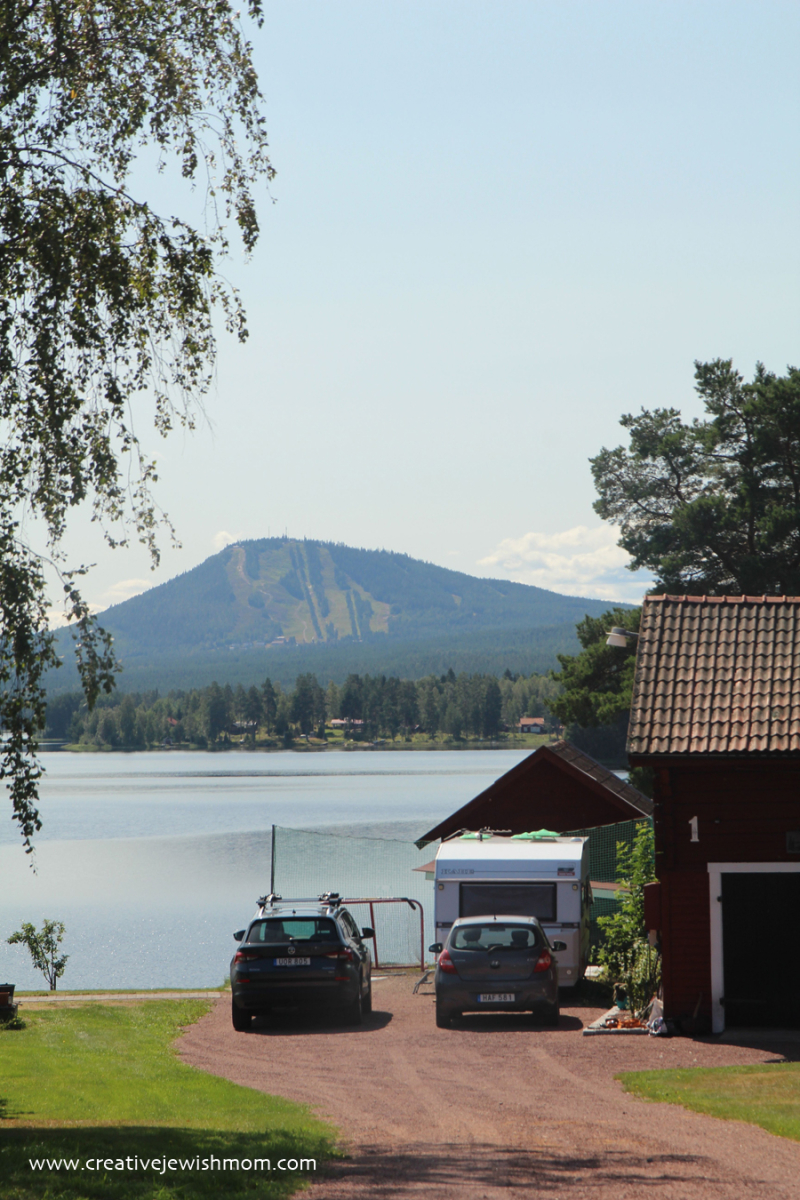Swedish-house-on-lake-Siljan-with-mountain