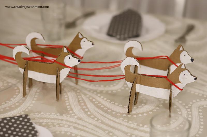 Cardboard-Huskies-pulling-birthday-cake