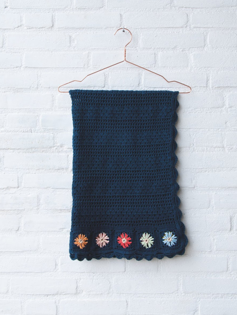 Crocheted-blanket-with-daisy-embroidery
