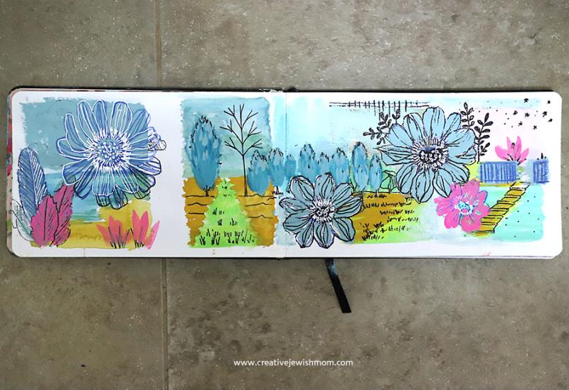Drawing-flowers-over-watercolors-sketchbook