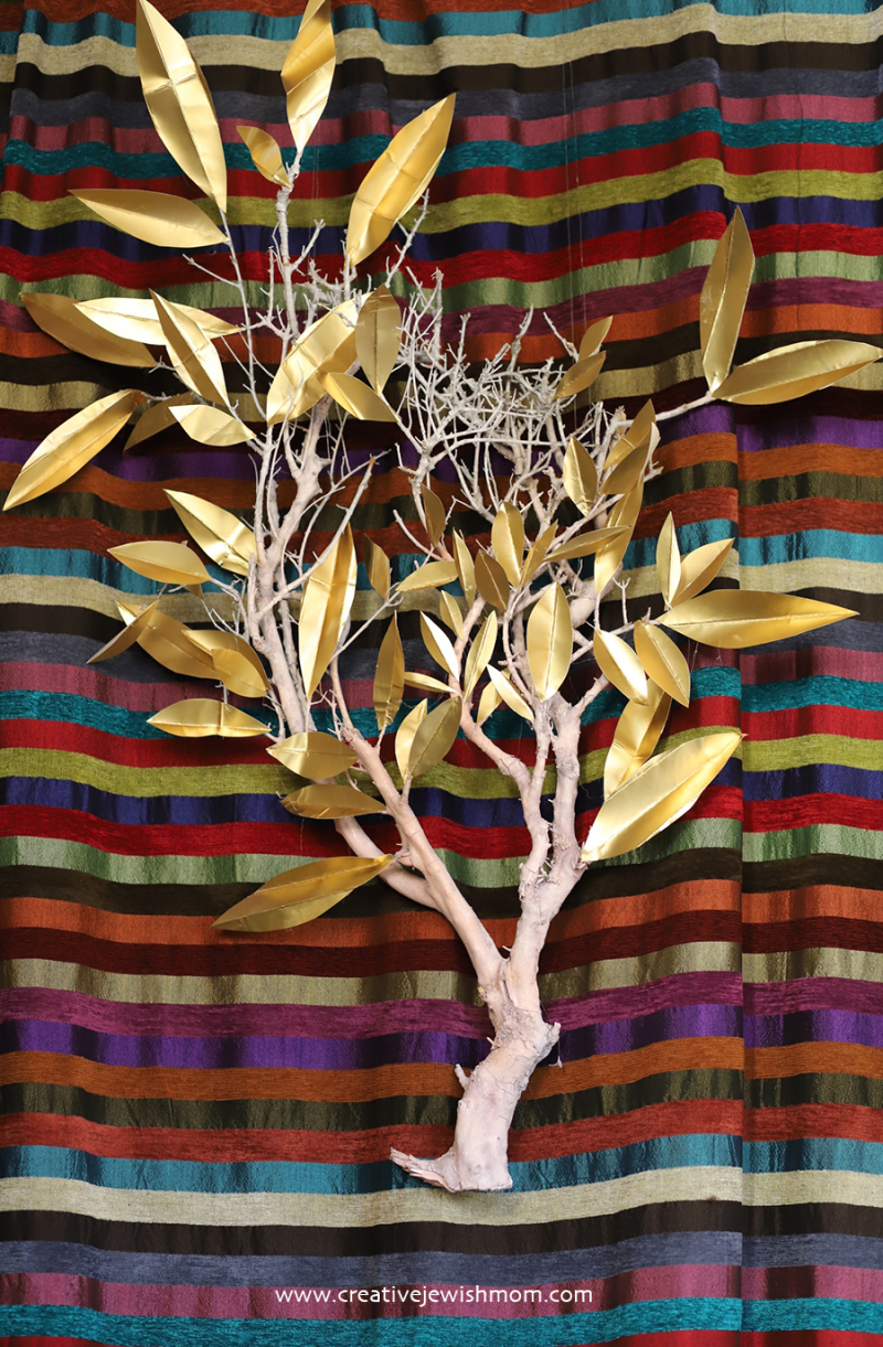 Tree-branch-with-gold-paper-leaves