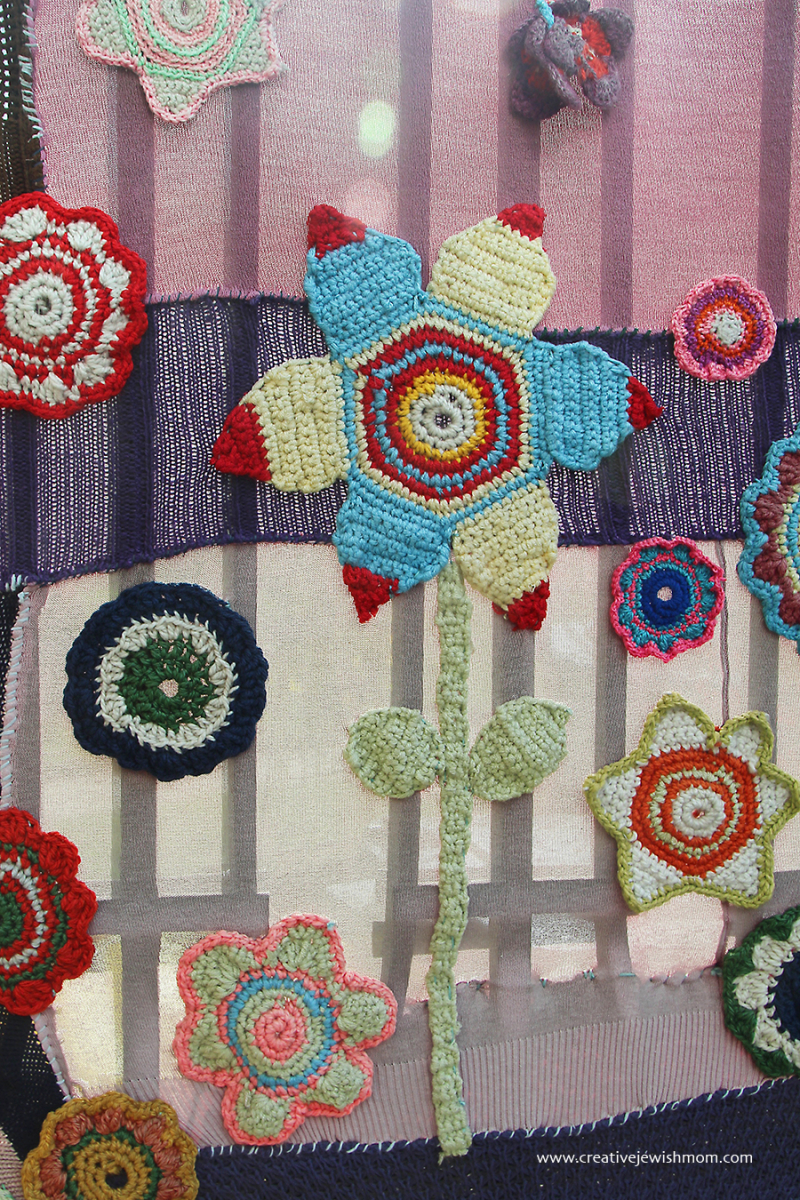 Crochet-flower-applique-yarn-bomb-mural