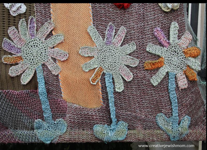 Giant-crochet-flower-applique-yarn-mural