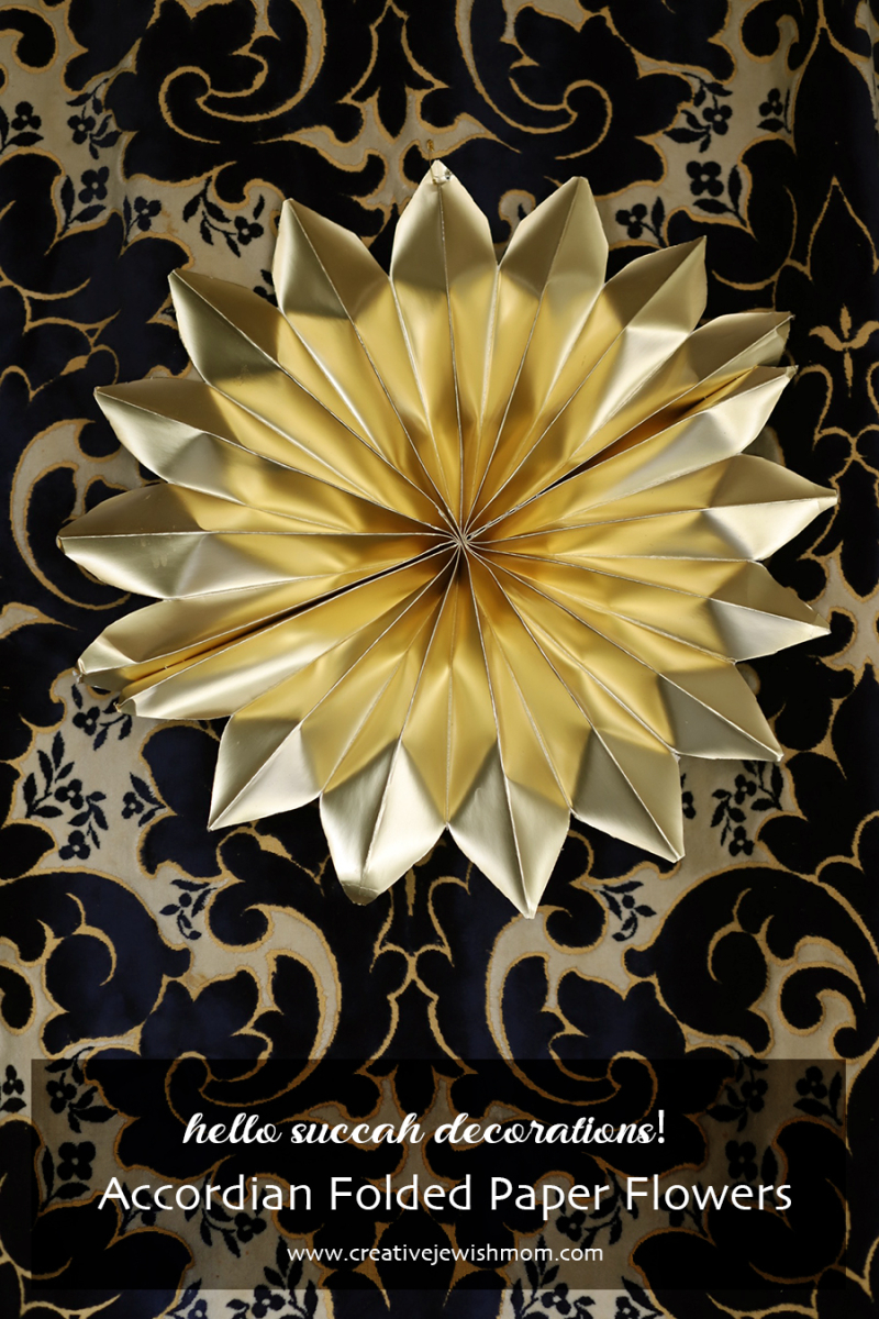 Paper-flower-gold-succah-decoration