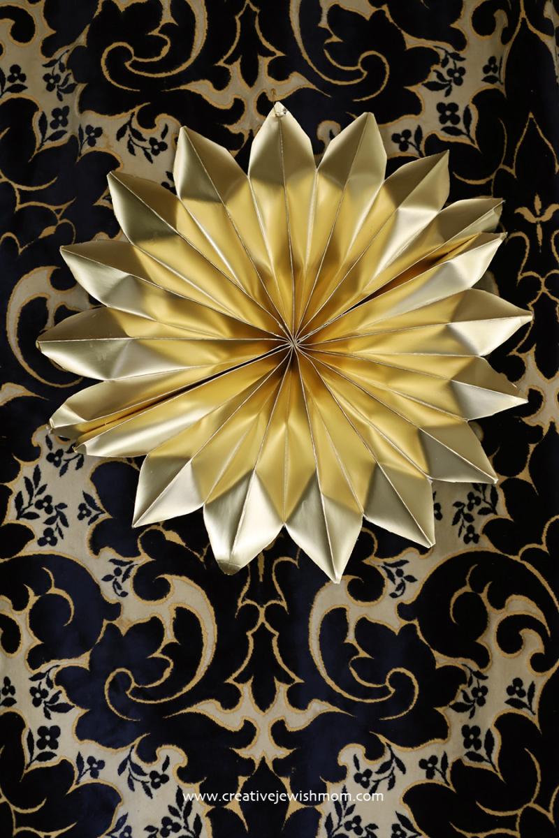 Paper-flower-gold-succah-decoration