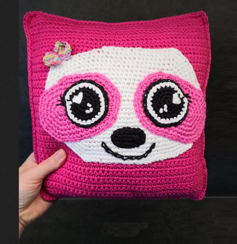 Crocheted-raccoon-pillow-pink
