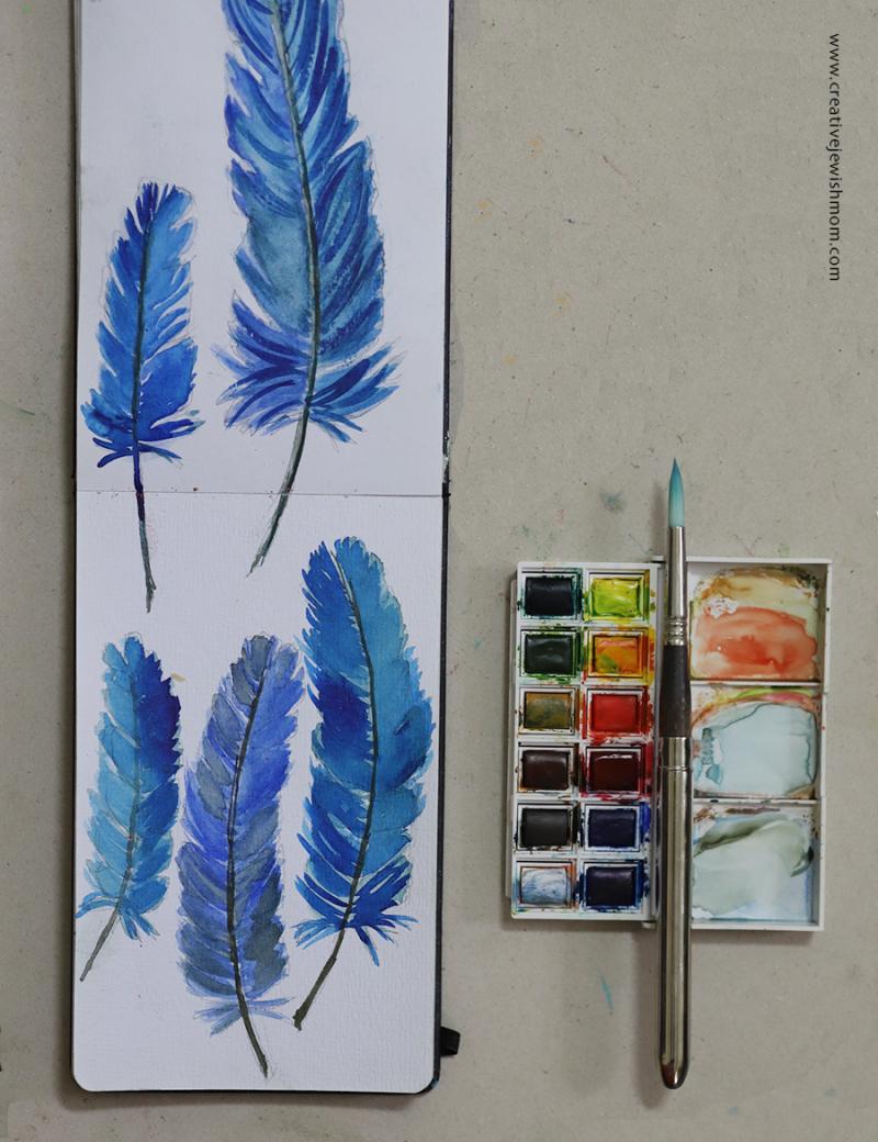 Watercolor-feathers-in-sketchbook