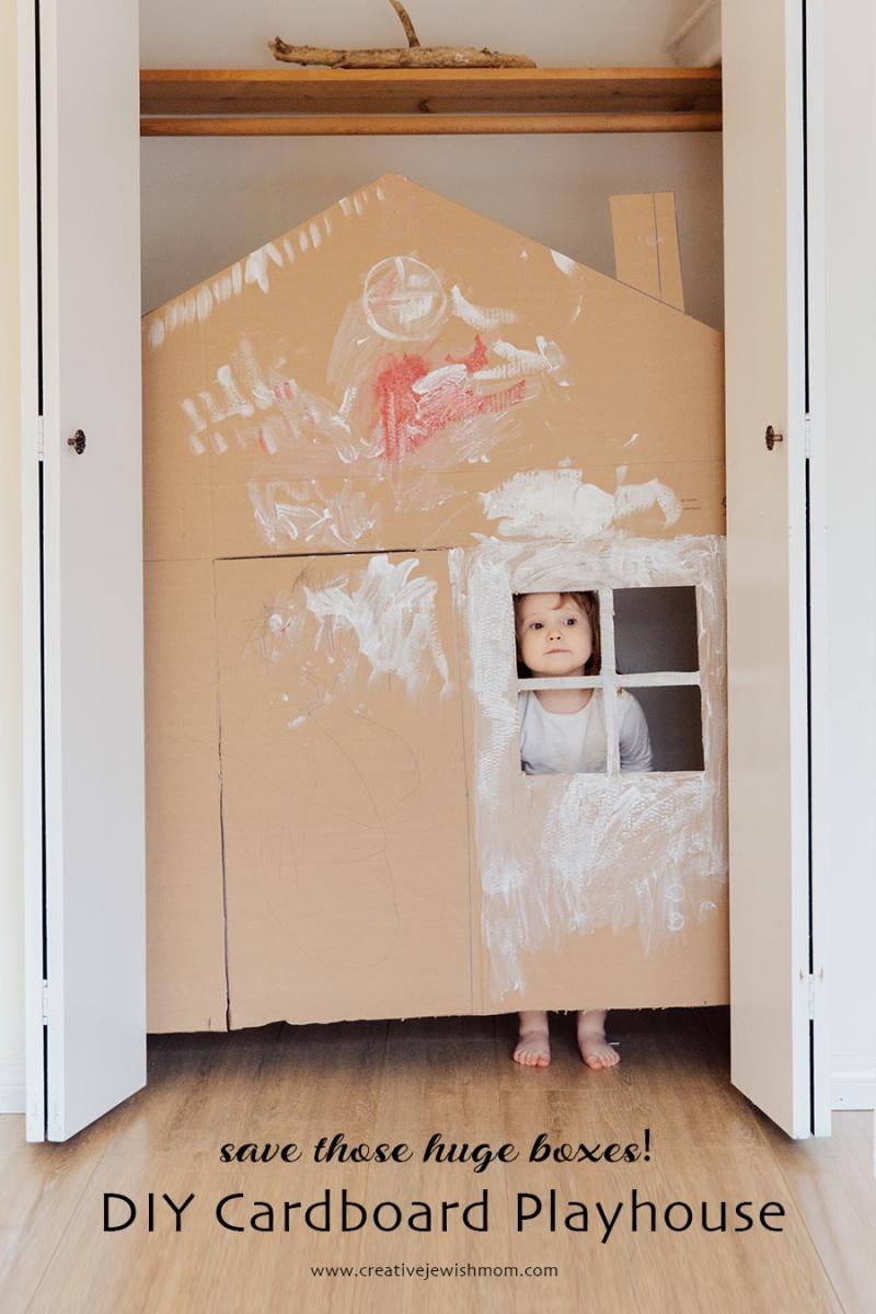 DIY cardboard playhouse in a closet