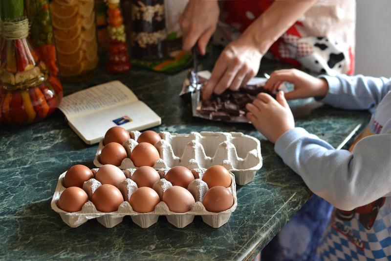 Kids cooking eggs
